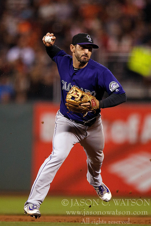 SAN FRANCISCO, CA - SEPTEMBER 29:  Daniel Descalso #3 of the Colorado Rockies throws to first base after fielding a ground ball against the San Francisco Giants during the eighth inning at AT&T Park on September 29, 2016 in San Francisco, California. The San Francisco Giants defeated the Colorado Rockies 7-2. (Photo by Jason O. Watson/Getty Images) *** Local Caption *** Daniel Descalso