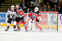 KELOWNA, CANADA, OCTOBER 20: MacKenzie Johnston #22 and Adam Brown #1 of the Kelowna Rockets defend the net as  the Vancouver Giants visited the Kelowna Rockets on October 20, 2011 at Prospera Place in Kelowna, British Columbia, Canada (Photo by Marissa Baecker/shootthebreeze.ca) *** Local Caption ***MacKenzie Johnston;Adam Brown;