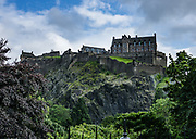 Perched atop Castle Rock, Edinburgh Castle is the most besieged place in Great Britain and one of the most attacked in the world, with 26 sieges in its 1100-year-old history. Few of the present buildings pre-date the Lang Siege of the 1500s except for St Margaret's Chapel from the early 1100s, the Royal Palace, and the early-1500s Great Hall. Edinburgh is the capital city of Scotland, in Lothian on the Firth of Forth, Scotland, United Kingdom, Europe.
