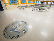 The original logo for Sterling High School in the current campus cafeteria is being preserved for use in the new school.