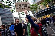 Frankfurt am Main | 28 Apr 2014<br /> <br /> Am Montag (28.04.2014) veranstalteten etwa 200 Menschen an der Hauptwache in Frankfurt am Main sogenannte Montagsdemos gegen Hartz IV und die Agenda 2010 und dann sp&auml;ter f&uuml;r den Frieden, gegen den Krieg etc., am zweiten Teil der Montagsdemo nahmen AfD-Aktivisten und die Neonazi-Aktivistin Sigrid Sch&uuml;&szlig;ler (NPD, RNF/Ring Nationaler Frauen) teil.<br /> Hier: Aktivistin mit einer Pappe mit der Aufschrift &quot;Wahrheit&quot;.<br /> <br /> &copy;peter-juelich.com<br /> <br /> [No Model Release | No Property Release]