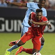 Daniel Sturridge, Liverpool, is challenged by Dedryck Boyata, Manchester City during the Manchester City Vs Liverpool FC Guinness International Champions Cup match at Yankee Stadium, The Bronx, New York, USA. 30th July 2014. Photo Tim Clayton