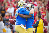 17 October 2012: Center (54) Jake Brendel of the UCLA Bruins hugs (23) Jonathan Franklin after Franklin scores a touchdown against the USC Trojans during the first half of UCLA's 38-28 victory over USC at the Rose Bowl in Pasadena, CA.