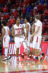29 December 2016:  Tony Wills(12) joins the time out huddle wearing a smile a during an NCAA  MVC (Missouri Valley conference) mens basketball game between the Evansville Purple Aces the Illinois State Redbirds in  Redbird Arena, Normal IL