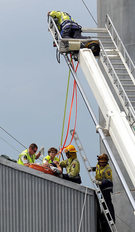 Fire and ambulance rescue a man after he fell from a grain silo onto a roof, Williams and Kettle Grain Store, Camberley, Hastings, Friday, November 23, 2012. Credit:SNPA / Kerry Marshall