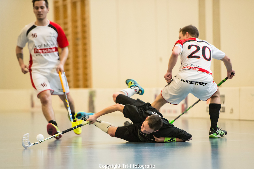 Floorball player falls on the floor