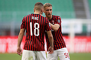 AC Milan's Croatian striker Ante Rebic celebrates with AC Milan's Belgian midfielder Alexis Saelemaekers after scoring to give the side a 1-0 lead during the Serie A match at Giuseppe Meazza, Milan. Picture date: 28th June 2020. Picture credit should read: Jonathan Moscrop/Sportimage