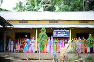 People line up to cast their ballot during the second phase of voting in parlimentary elections April 23, 2009 in the town of Adabari in the state of Assam, India. Polling took place amid tight security after several acts of militant violence in recent days.
