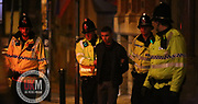 Manchester UK  24.12.2016: Images from Manchesters Gay Village during the Mad Friday celebrations this on the 23 and 24th of December,<br /> <br /> A man is lead away in handcuffs by police