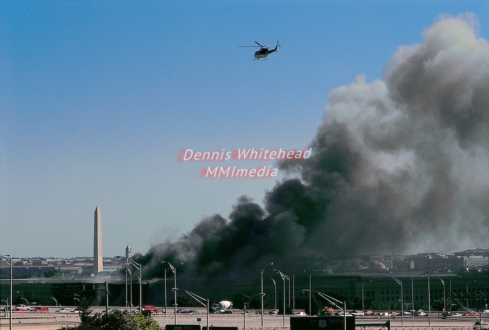 Smoke rises from the Pentagon in Arlington, VA on September 11, 2001 following a terrorist attack on the buidling.