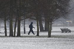 © Licensed to London News Pictures. 01/03/2018. London, UK. People make their way to work on Clapham Common after more snow fell overnight. The 'Beast from the East' and Storm Emma have brought extreme cold and heavy snow to the UK. Photo credit: Peter Macdiarmid/LNP