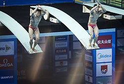 WUHAN, June 5, 2018  China's Cao Yuan (L) and Xie Siyi compete during the men's 3m springboard synchronised final at the FINA Diving World Cup 2018 in Wuhan, central China's Hubei Province, on June 5, 2018. Cao Yuan and Xie Siyi claimed the title with a total of 448.74 points. (Credit Image: © Xiao Yijiu/Xinhua via ZUMA Wire)