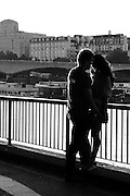 A couple enjoys a oment along the banks of the River Thames, London