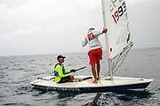 World Sailing Emerging Nations Program - Boca Chica Sailing Club, Santo Domingo 08/19/2017 - DAY 2 - Martin Manrique coach for Curazao talks to his sailor Darius Berenos standing up on his boat