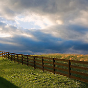 A weather front stirs up dramatic clouds before sunset in this open field in Loudoun County, Virginia.