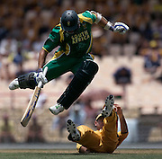 South Africa's Andre Nel jumps over Australia's Ricky Ponting during their World Cup cricket semi-final in Gros Islet, St. Lucia. (2007)