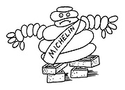 (Michelin man propped up on bricks)