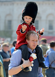 © Licensed to London News Pictures. 23/05/2012. London, UK Ollie 'H' watches the Guard wearing a red Guards uniform. Canadian Mounties Guard Her Majesty the Queen at Horse Guards Parade on Whitehall in Westminster. They will guard on all day and will be the first non-British force to guard the Queen. Photo credit : Stephen Simpson/LNP