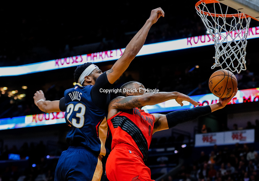 Jan 12, 2018; New Orleans, LA, USA; Portland Trail Blazers guard Damian Lillard (0) shoots as New Orleans Pelicans forward Anthony Davis (23) defends during the second half at the Smoothie King Center. The Pelicans defeated the Trail Blazers 119-113. Mandatory Credit: Derick E. Hingle-USA TODAY Sports