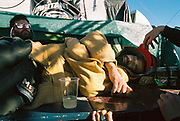 A man naps at Vina Tek, Toledo, Spain 2017