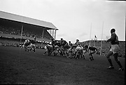 Rugby International, Ireland v Wales, Lansdowne Road, Dublin.  Kiely, Irish forward, holds off the opposition as Ireland's scrum, J.C. Kelly, gathers the ball following a loose scrum.<br /> 17.11.1962