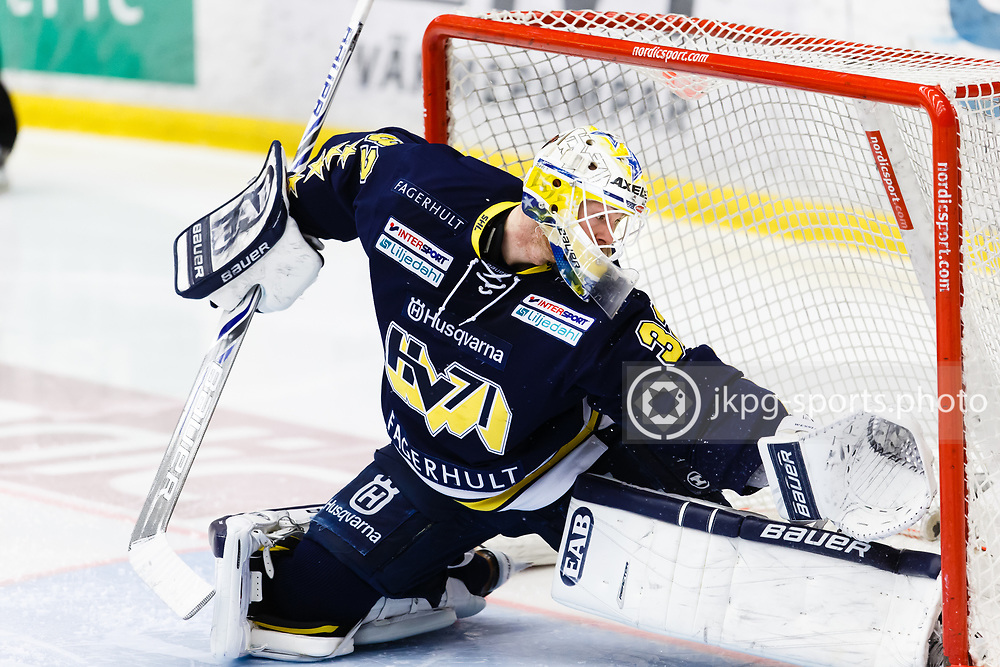 150305 Ishockey, SHL, HV71 - Skellefte&aring;<br /> Gustaf Wesslau, HV71 g&ouml;r ett ingripande i m&aring;let, single action.<br /> &copy; Daniel Malmberg/All Over Press