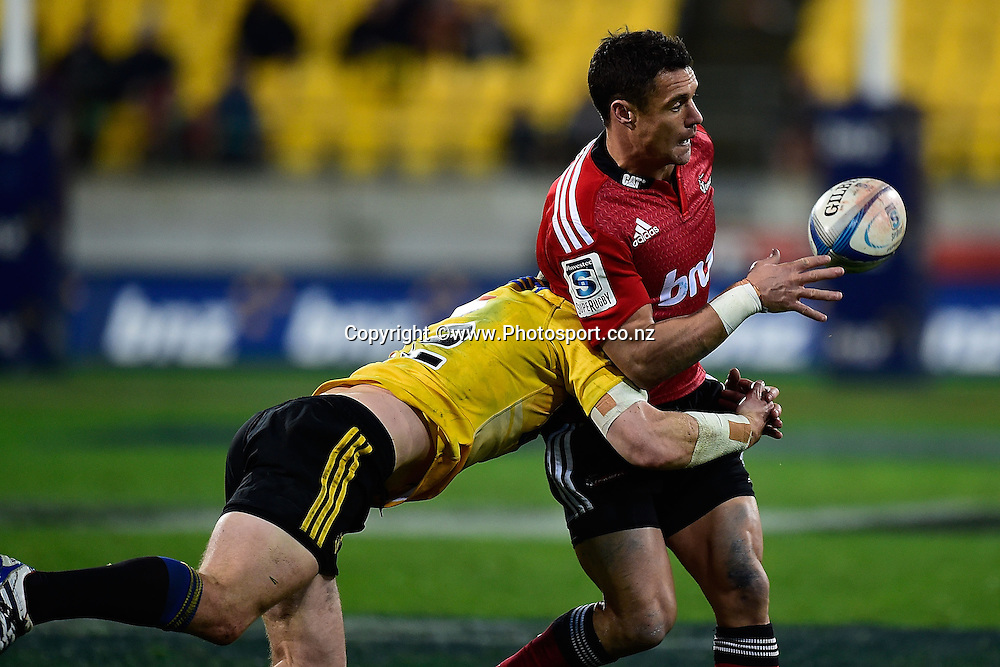 Dan Carter of the Crusaders is tackled by Alapati Leiua of the Hurricanes during the Super Rugby - Hurricanes v  Crusaders rugby match at the Westpac Stadium in Wellington, New Zealand on the 28th of June 2014. Photo: Marty Melville/www.Photosport.co.nz