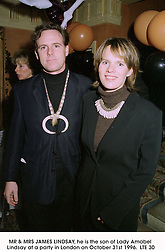 MR & MRS JAMES LINDSAY, he is the son of Lady Amabel Lindsay at a party in London on October 31st 1996. LTE 30