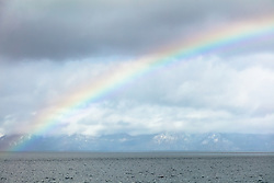 """""""Rainbow Over Lake Tahoe 1"""" - Photograph of a vibrant rainbow over Lake Tahoe, shot from just north of Kaspian Point on the west shore."""