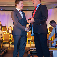 Shane McGrath from Feakle receiving his U21 Hurling medal from Former Senior manager, Ger Loughnane