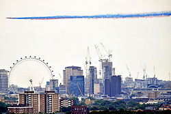 © Licensed to London News Pictures. 10/07/2018<br /> Greenwich, UK.<br /> Military aircraft flypast above London to celebrate the  centenary of the RAF, watch by crowds at Greenwich Park, Greenwich. Red Arrows.<br /> Photo credit: Grant Falvey/LNP