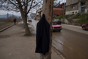 A coat hangs at a construction site on the limited Albanian zone of the North Ibar river in Kosovska Mitrovica.