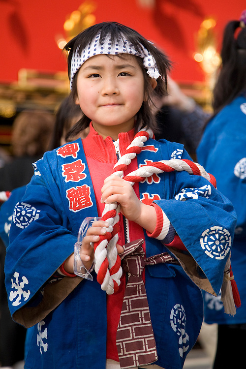 Asia, Japan, Gifu prefecture, Takayama (also known as Hida-Takayama), girls in traditional clothing in Gonjunko Procession during Sanno Festival of Hie Jinja Shrine, held annually in April.