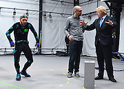 "© Licensed to London News Pictures. 04/04/2013. London, UK Actor Matt cross gestures whilst Boris Johnson the Mayor of London, visits Ealing studios today, 4th April 2013, where he announced his plans to boost London's TV, Animation and Film industries, capitalising on the new tax relief brought in by the Chancellor (from 1st April 2013) to bring major jobs and investment to the capital. He toured the Studios and spent time in the ""Imaginarium"", where he had a go at mastering 'performance capture'. . Photo credit : Stephen Simpson/LNP"