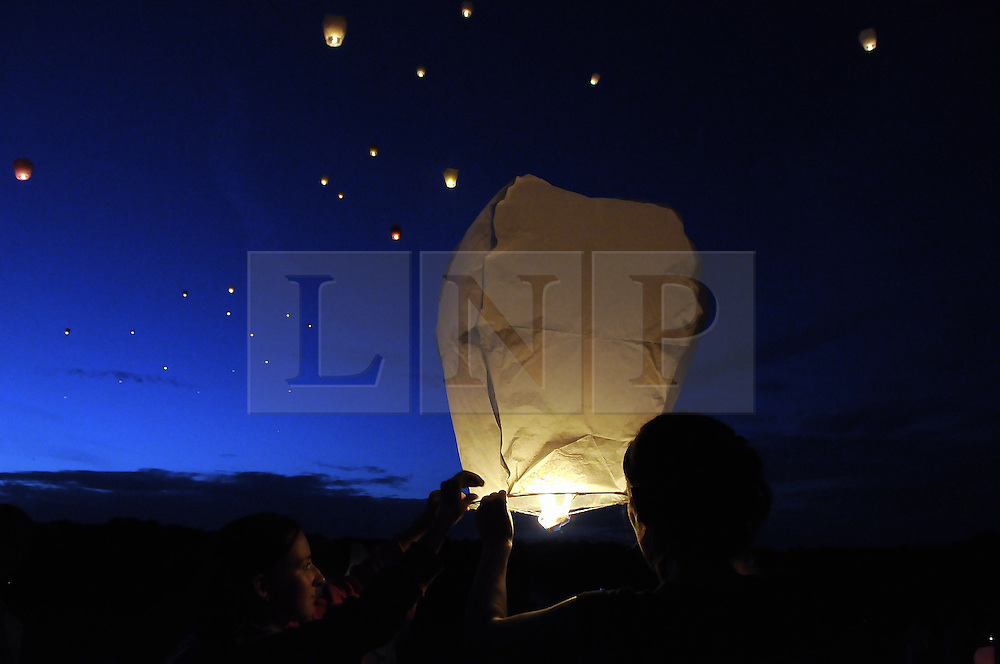 © Licensed to London News Pictures. 17/08/2012.The community of The Fieldway Estate in New Addington has come together tonight (17/08/2012) to light Lanterns in memory of murdered 12 year old school girl Tia Sharp who's body was found one week ago in her Grandmothers house at 20 The Lindens on the estate. The lighting took place on the recreation ground next to the Timebridge Community Centre at 9pm..Photo credit : Grant Falvey/LNP