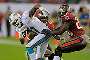 Miami Dolphins wide receiver Mike Wallace (11) is tackled by Tampa Bay Buccaneers cornerback Darrelle Revis (24) during the Bucs 22-19 win at Raymond James Stadium on Nov. 11, 2013 in Tampa, Florida. <br /> <br /> &copy; 2013 Scott A. Miller