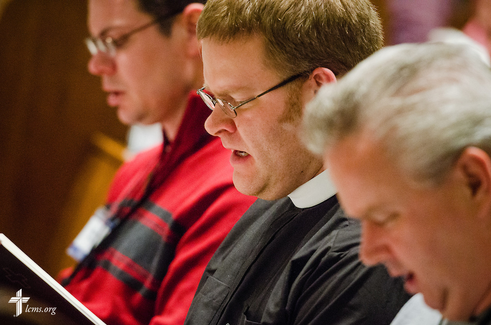 The Rev. Brandon Froiland prays during the DOXOLOGY Encore evening prayers in Springfield, Ill., on Friday, Feb. 21, 2014. LCMS Communications/Erik M. Lunsford