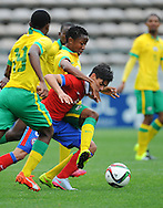 CAPE TOWN, SOUTH AFRICA - Sunday 27 September 2015: Tebogo Qinisele of South Africa is challenged by Yerko Leiva of Chile during the U17 International friendly soccer match between South Africa v Chile at Athlete Stadium. (Photo by Roger Sedres/ImageSA)