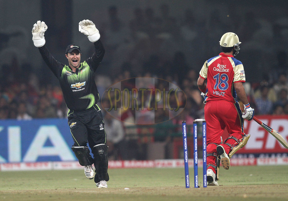 Mark Boucher of the Warriors appeals unsuccessfully for a run out during match 1 of the NOKIA Champions League T20 ( CLT20 )between the Royal Challengers Bangalore and the Warriors held at the  M.Chinnaswamy Stadium in Bangalore , Karnataka, India on the 23rd September 2011..Photo by Shaun Roy/BCCI/SPORTZPICS