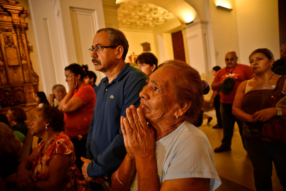 A crying woman prays for President Hugo Chavez during a special mass and prayer vigil for his health in Caracas, Venezuela on December 31, 2012. President Chavez is currently in Cuba recovering from recent cancer surgery.