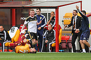 Scott McDonald take a sore one during the Ladbrokes Scottish Premiership match between Motherwell and Aberdeen at Fir Park, Motherwell, Scotland on 15 August 2015. Photo by Craig McAllister.