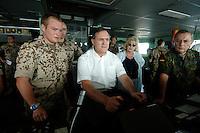 """25 SEP 2006, GOLF VON TADJURA/DJIBOUTI:<br /> Franz Josef Jung (M), CDU, Bundesverteidigungsminister, am Ruder, auf der Bruecke der Fregatte """"Schleswig-Holstein"""", die als Flaggschiff Teil des deutschen Marinekontingents der OPERATION ENDURING FREEDOM ist und im Seegebiet am Horn von Afrika operiert, rechts: und Wolfgang Schneiderhan, Generalinspekteur der Bundeswehr <br /> IMAGE: 20060925-01-107<br /> KEYWORDS: Dschibuti, Bundeswehr, Marine, Soldat, Soldaten, Afrika, Africa"""