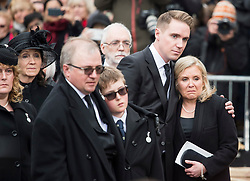 © Licensed to London News Pictures. 31/03/2018. Cambridge, UK. TIMOTHY HAWKING (son) hugs his sister LUCY HAWKING (Daughter) as at the coffin leaves the funeral of Stephen Hawking at Church of St Mary the Great in Cambridge, Cambridgeshire. Professor Hawking, who was famous for ground-breaking work on singularities and black hole mechanics, suffered from motor neurone disease from the age of 21. He died at his Cambridge home in the morning of 14 March 2018, at the age of 76. Photo credit: Ben Cawthra/LNP