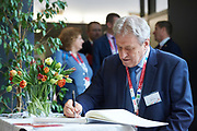 Graz, Austria - 2017 March 18: Yuri Smirnov from Russia (Deputy Leader of the Russian Duma and President, Special Olympics Russia) signs Memorial Book during Global Forum on Inclusion in Social Affairs and Sports while Special Olympics World Winter Games Austria 2017 at Convention Centre Messe Graz on March 18, 2017 in Graz, Austria.<br /> <br /> Mandatory credit:<br /> Photo by &copy; Adam Nurkiewicz / Mediasport<br /> <br /> Adam Nurkiewicz declares that he has no rights to the image of people at the photographs of his authorship.<br /> <br /> Picture also available in RAW (NEF) or TIFF format on special request.<br /> <br /> Any editorial, commercial or promotional use requires written permission from the author of image.<br /> <br /> Image can be used in the press when the method of use and the signature does not hurt people on the picture.
