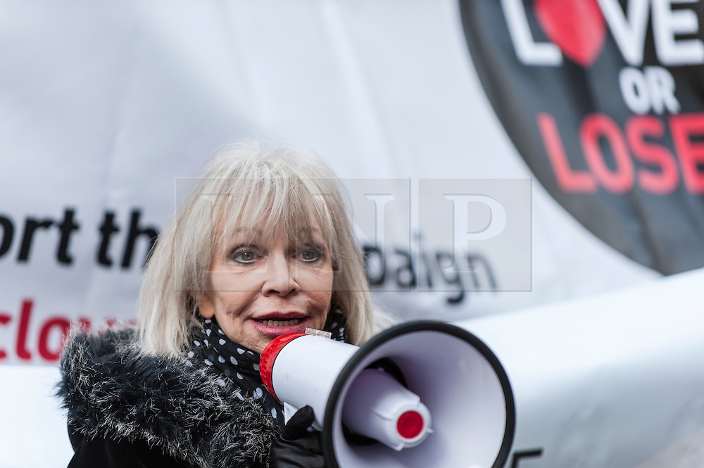 """© Licensed to London News Pictures. 23/11/2015. LONDON, UK. Former Doctor Who girl, Katy Manning, addresses fans of Doctor Who known as """"Whovians"""" and other supporters of the BBC gathered outside Broadcasting House in central London to oppose the threat of 20% government cuts to the Corporation which has brought shows such as Dr Who since 1922. Photo credit : Stephen Chung/LNP"""