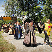 Queen Margaret of Scotland, portrayed by Janna Lewis, and King Robert the Bruce, portrayed by Karl Licht, lead a procession of royal characters at the Highland Renaissance Festival in Eminence, Ky., on 6/19/10. Lewis anPhoto by David Stephenson