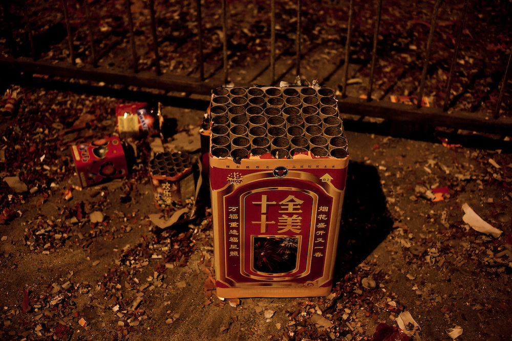 Millions of fireworks and crackers are exploding at the same time in the whole China during the hour of the passage to the old year (of the Rabbit) to the very expected Year of the Dragon. Beijing, January 22-23. Here in the center near Beixinqiao.