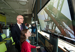 Pictured: Education Secretary John Swinney MSP tries out one of the new interatcive  games with 10 year old Niamh McCormack from Queensferry Primary school.<br /> <br /> &copy; Dave Johnston / EEm