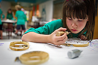 "Maggie Baldeck, 8, contemplates her next application of glitter dye onto her silk project during the Citizen's Council for the Arts ""ArtShop"" held Tuesday at Hayden Meadows Elementary."