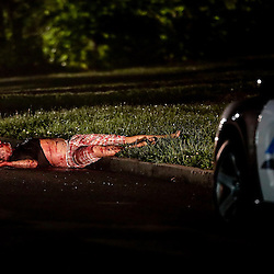 KYLE GREEN | The Roanoke Times;<br /> [5/7/2013 A bloody body lays in the street in the 1400 block of Abbott St NW, in Roanoke, Virginia on Tuesday night. Officers responded to the 1400 block of Abbott Street Northwest near its intersection with Florida Avenue about 8:40 p.m. Tuesday for a report of gunshots, according to Sgt. A.H. Pulley. Police spokeswoman Aisha Johnson said two men were found shot. One man was found lying on Abbott Street and was pronounced dead at the scene, she said. ]